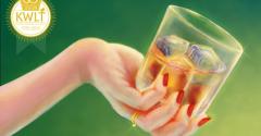 Illustration of feminine hand holding glass of alcohol